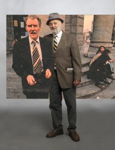 Playwright Bob Sarti poses with an image of the late Bruce Erikson
